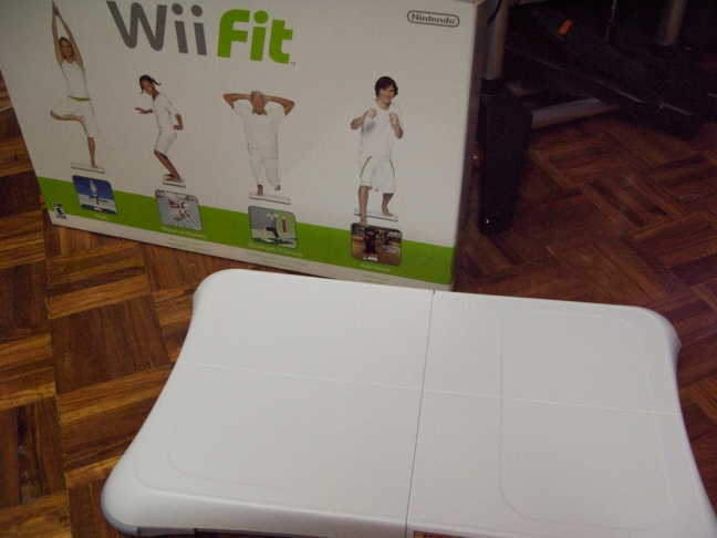 This photo shows the Wii Fit box and balance board