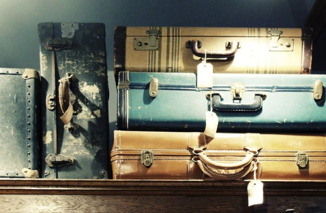 This photo shows a stack of vintage suitcases