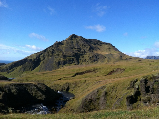 This photo shows a mountain along the Skogafoss river trail in southern Iceland