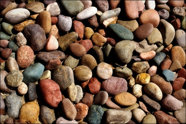 This photo shows a pile of stones in all different sizes and colors