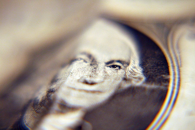 This photo shows a closeup of George Washington's image on the US $1 bill